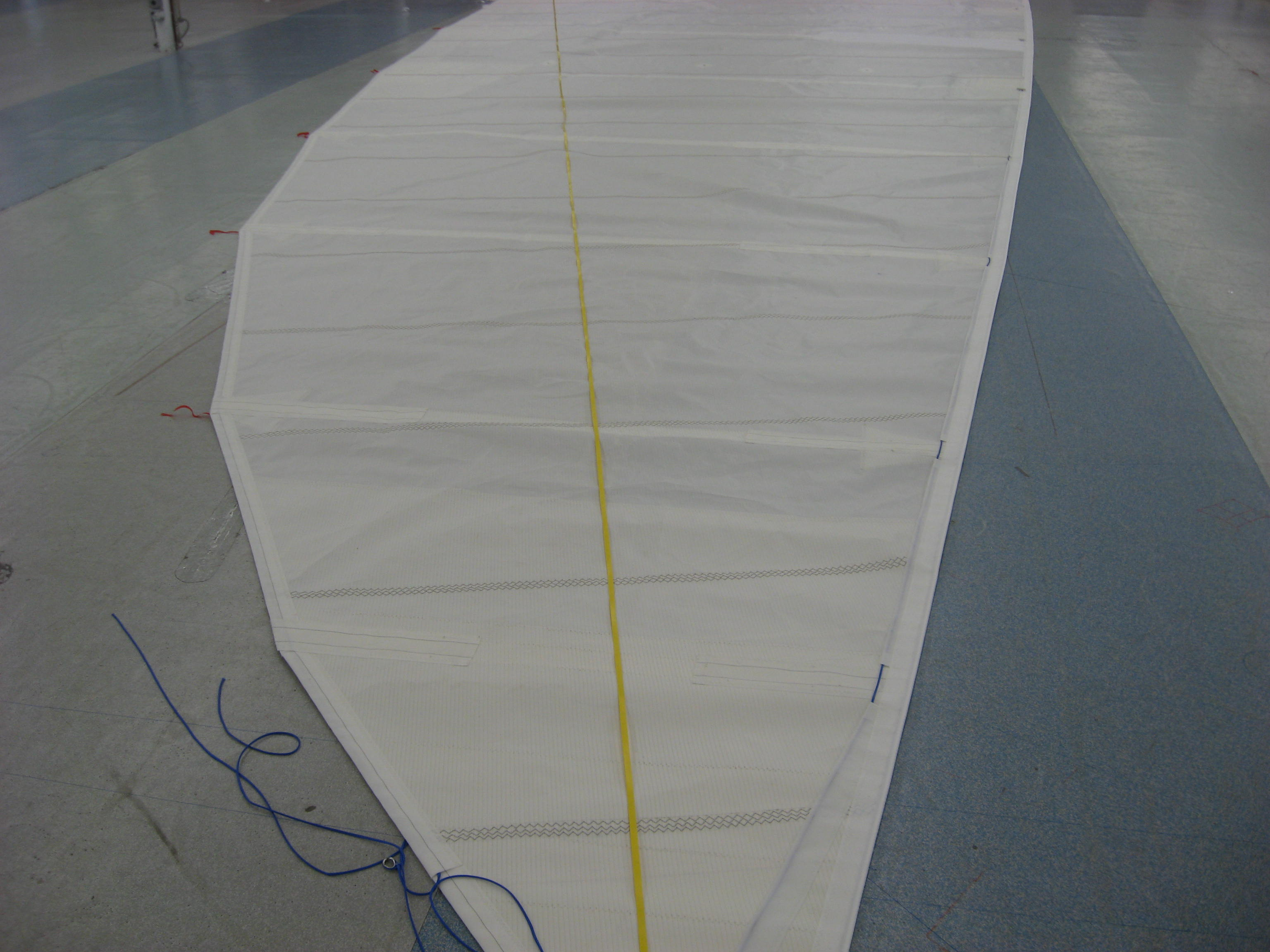 The yellow line leading from the head, at the bottom of the image, to the clew at the top, is the straight line leech. All the sail to the image left of this line is roach. This of course requires considerable detail (read cost) in making sure the sail will be robust enough for hard offshore work typical of Deer foot owners.