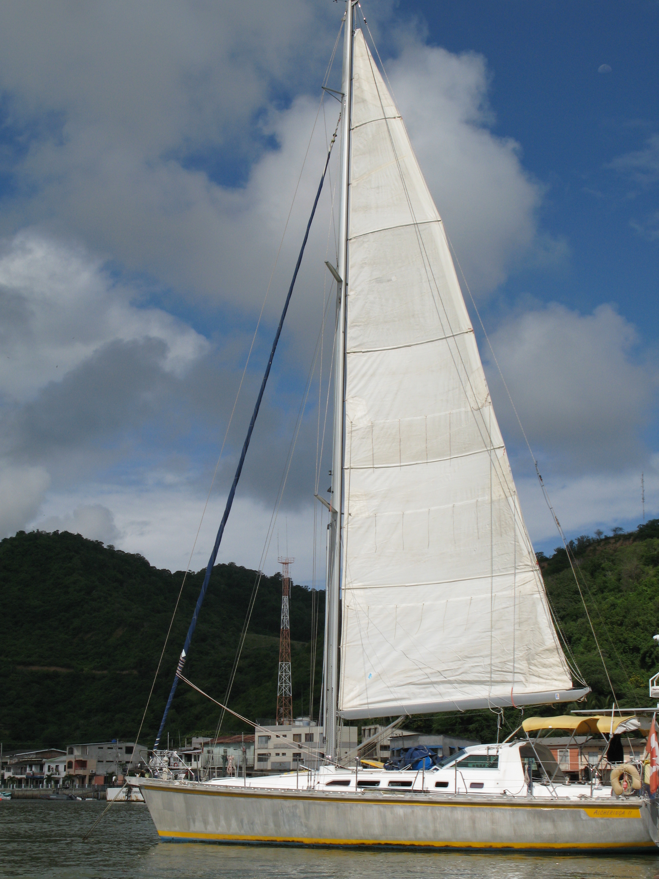 This cruising main has a very conservative roach, almost  nothing. The owners commissioned a new sail and specified a much larger roach, so big in fact that when tacking they had to lower the mainsail a few feet.