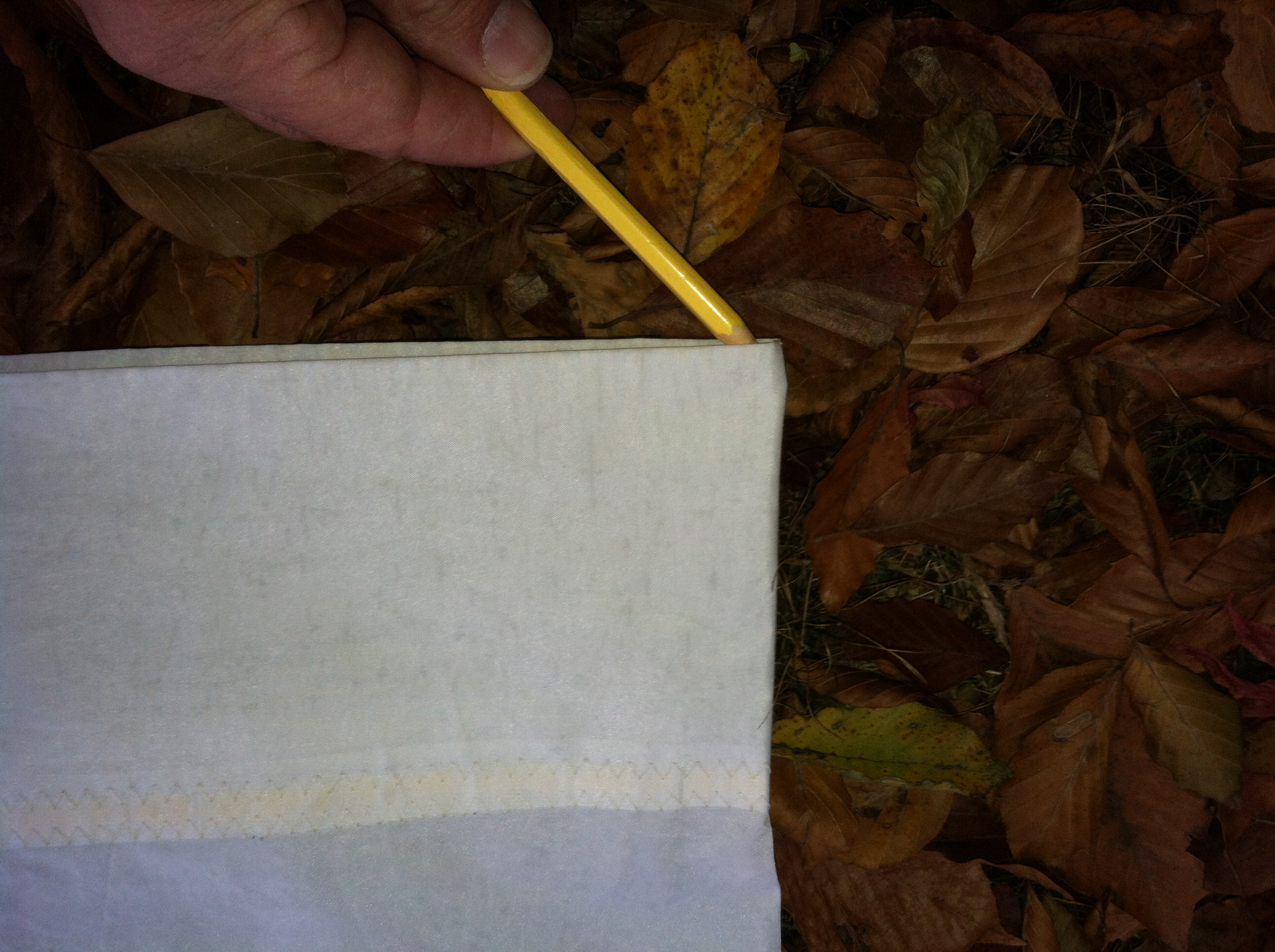 Make a pencil mark on the sail under the fold.