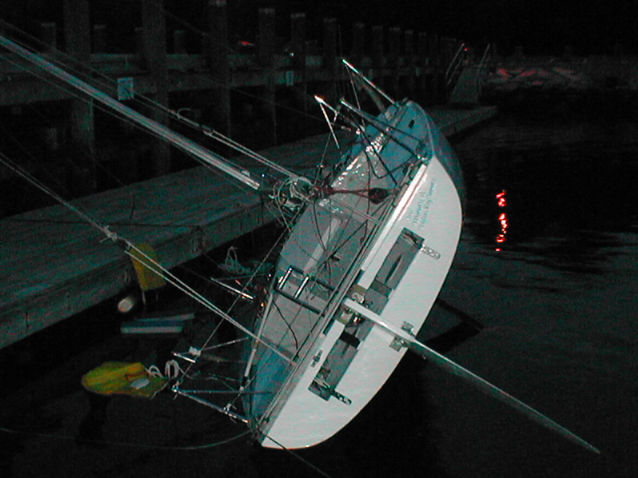 "While not used in ""normal"" yacht races, the physical testing of a boats stability is normal in the open classes, as evidenced here by the pull down test for a 6.5 meter Mini-Transat boat. FOr the Newport to Bermuda race, the Organizing Authority refers to a boats rating certificates and imposes regulations on stability from that data."