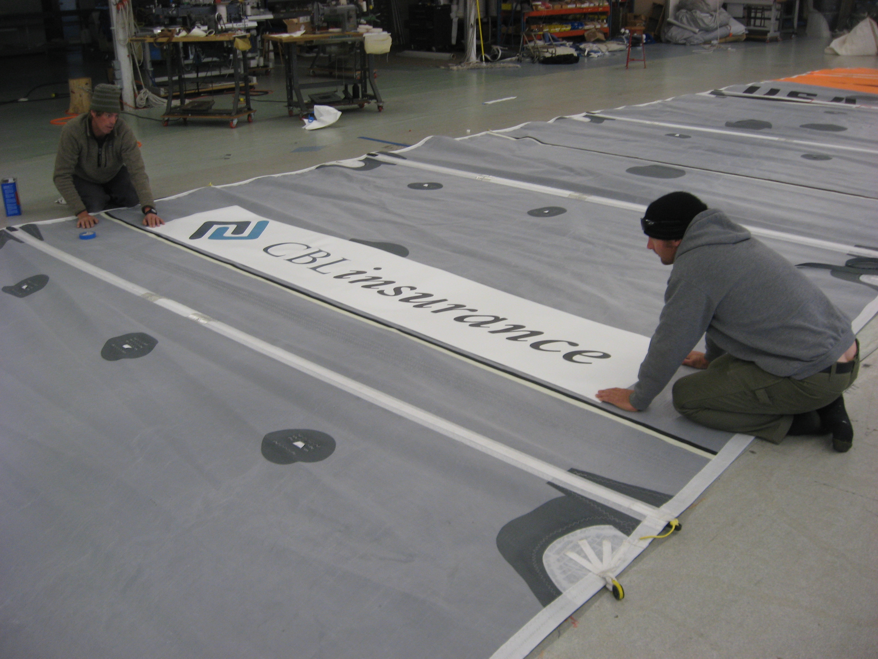 CBLK insurance NZL logo going onto Joe Harris's mainsail