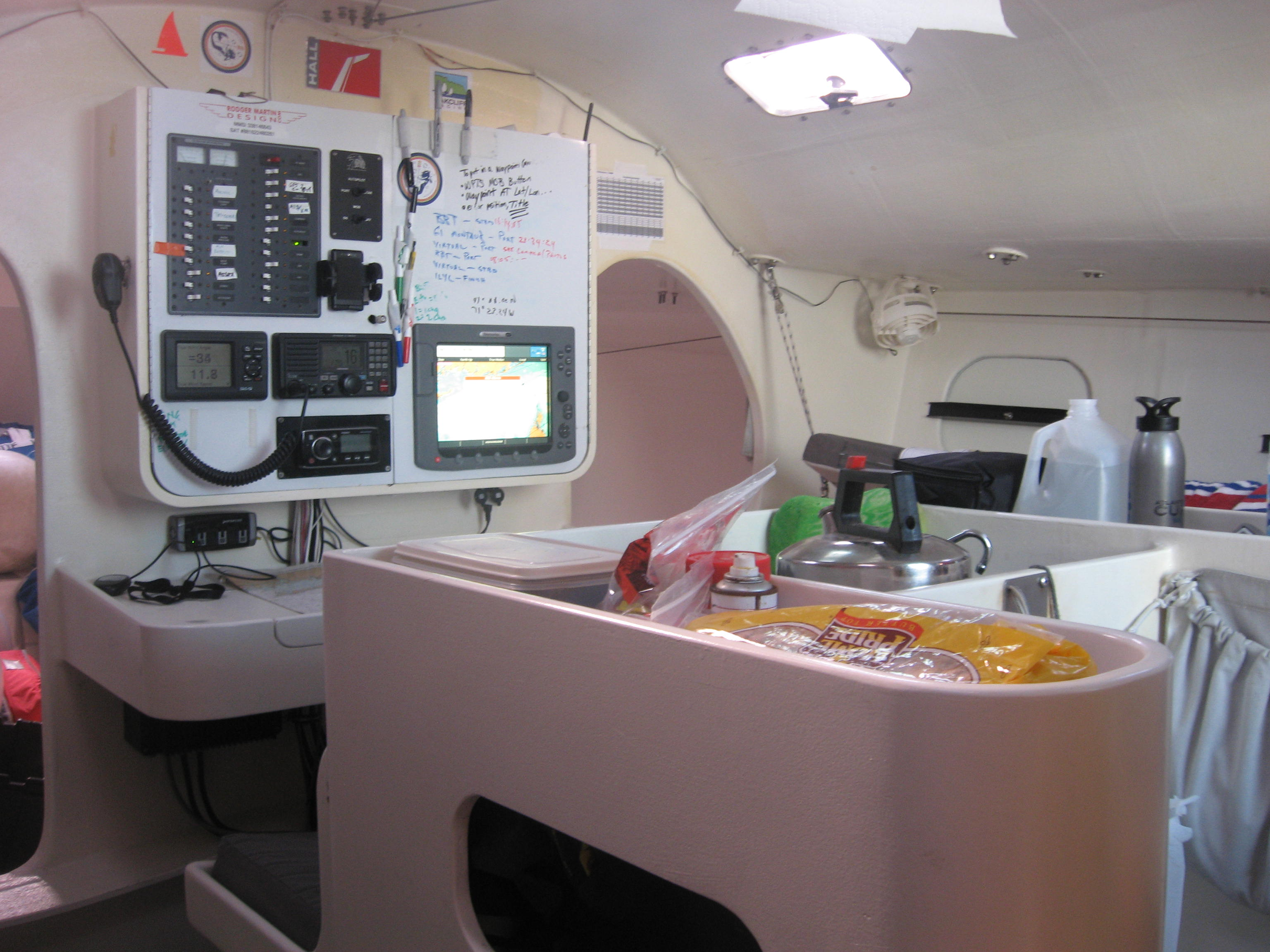 "This is the inside of a Class 40. Not Joe's but they are all basically very similar. In this image, you see the ""chart"" table across the top of the ""galley"". Lap of luxury they are not but they are great boats to be at sea on, especially for this kind of voyage."